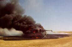 Moissoneuse John Deere en feu